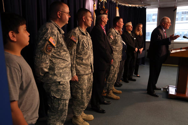 Illinois Governor Pat Quinn makes a plea for tax payer support of Illinois Military Family Relief Fund with a tax check-off. Army Sgt. Jason Hoster benefited from the program.