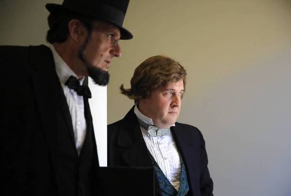George Buss as Abraham Lincoln and Tim Connors as Stephen Douglas at the Grayslake Heritage Center's Lincoln-Douglas debate event.