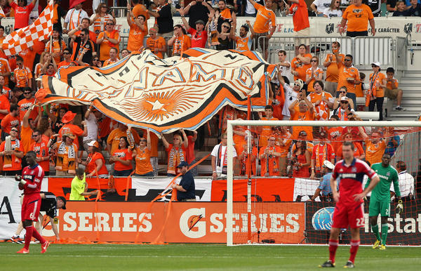 Houston fans celebrate after the Dynamo scored a goal during the first half against the Fire.