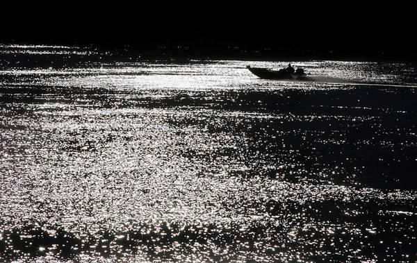 A boater glides over the Sacramento River near the town of Rio Vista, in the heart of the Sacramento-San Joaquin River Delta.