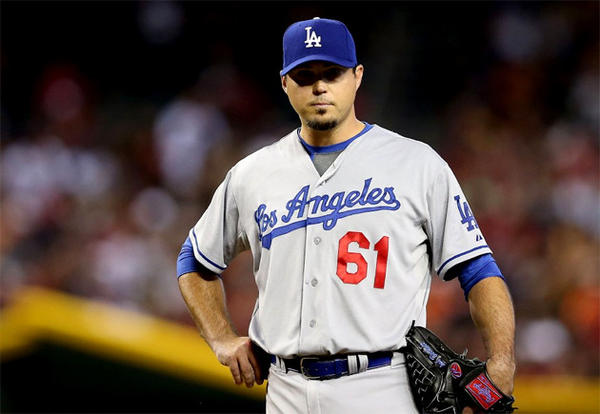 Dodgers starter Josh Beckett didn't allow a run until the bottom of the ninth.