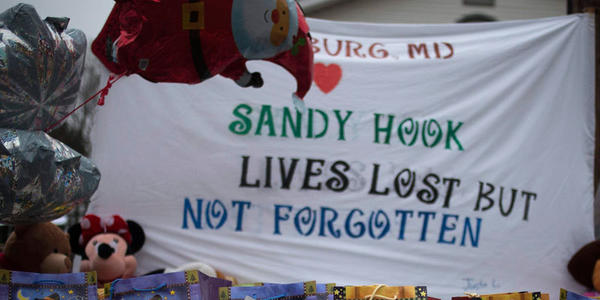 A December memorial along a road leading to Sandy Hook Elementary School after the school shooting.
