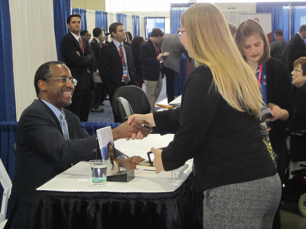 "Dr. Ben Carson signing his book, ""America the Beautiful: Rediscovering What Made This Nation Great,"" following his speech at the Conservative Political Action Conference on March 16, 2013 at Gaylord National Resort and Convention Center in Prince George's County."