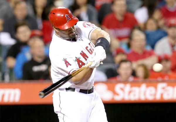 Angels slugger Albert Pujols was supposed to play first base on Sunday, but Manager Mike Scioscia changed plans.