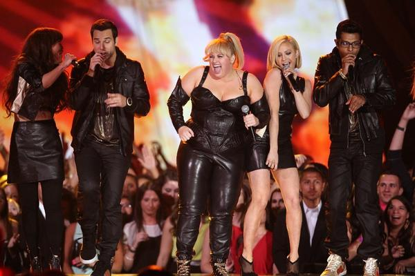 "Host Rebel Wilson and the cast of ""Pitch Perfect"" perform onstage at the MTV Movie Awards at the Sony Pictures Studio lot."