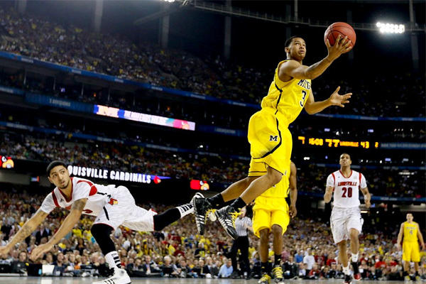 Michigan guard Trey Burke, right, is leaving the Wolverines to enter the NBA draft.