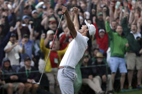 Adam Scott celebrates after making a birdie putt on the second playoff hole to win the Masters on Sunday.