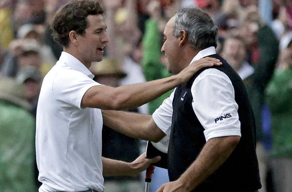 Adam Scott, left, and 2009 champion Angel Cabrera embrace after Scott made a 12-foot birdie putt to win the Masters on the second playoff hole Sunday.
