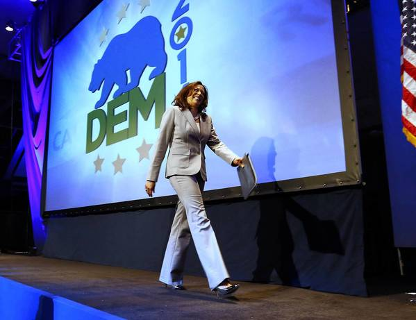 California Atty. Gen. Kamala D. Harris walks on stage to address delegates at the Democratic Party state convention in Sacramento. She implored fellow Democrats to push initiatives including immigration reform, gay marriage rights and stricter gun laws.