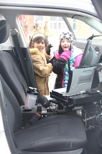 Abril Sot-Soa, left, and Nevaeh Stucke check out the inside of a vehicle from the Aberdeen Police Department.