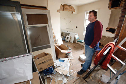 Devin Hebeisen, pastor of the Journey Church, stands in an apartment that needs to be renovated in the Journey Home, where those who need a hand can find shelter.