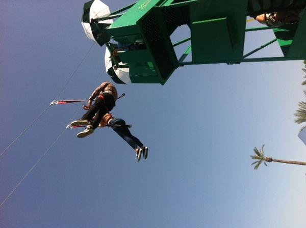 Guests at the Mirage poolside lounge enjoyed a zip line ride on Sunday near the Coachella Valley Music and Arts Festival.