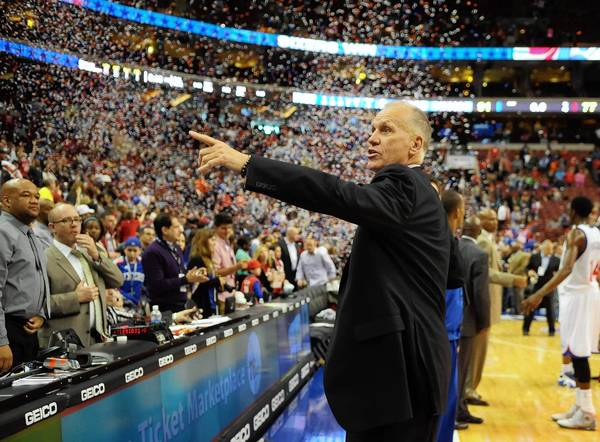 Philadelphia 76ers head coach Doug Collins acknowledges the crowd after the team's final home game against the Cleveland Cavaliers at the Wells Fargo Center. The 76ers defeated the Cavaliers, 91-77.