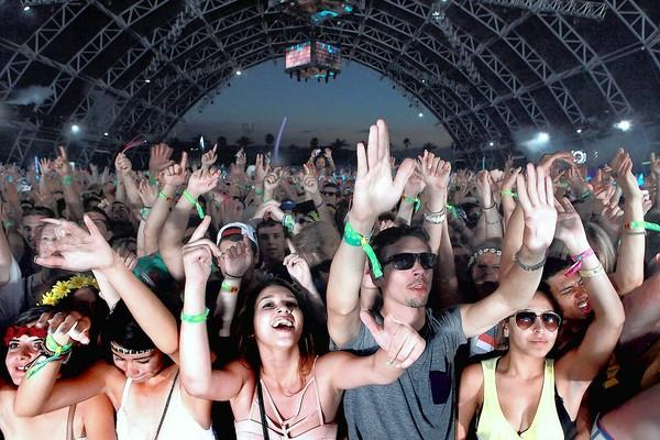 Fans in the Sahara tent dance to Dog Blood.