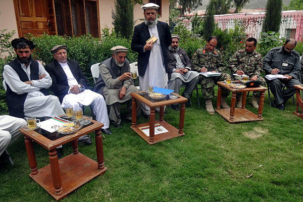 A government delegation visits Kunar on April 8 to investigate the killing of Afghan children in a NATO airstrike.