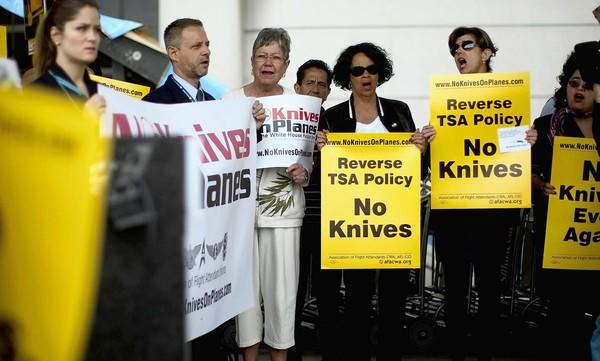 In the last few weeks, the Assn. of Professional Flight Attendants has sent letters to the TSA and others, voicing opposition to the policy change that will soon let airline passengers carry small folding knives on planes. Above, flight attendants from United and American airlines protest TSA's new policy at Los Angeles International Airport on April 1.