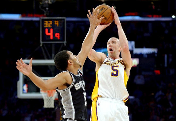 Lakers guard Steve Blake shoots over Spurs guard Cory Joseph during Sunday's game against San Antonio.