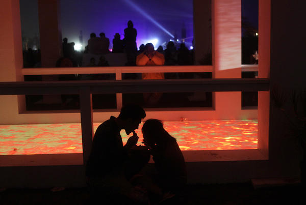 A couple enjoy a quiet meal at the Mirage, an art installation on the grounds of Coachella.