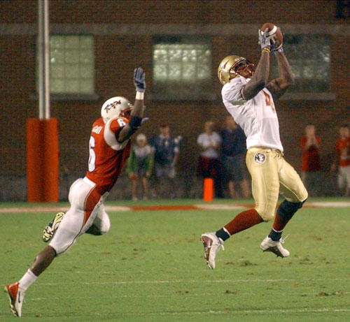 Florida State wide receiver Anquan Boldin (right) makes a catch in front of Maryland defensive back Domonique Foxworth in 2002.