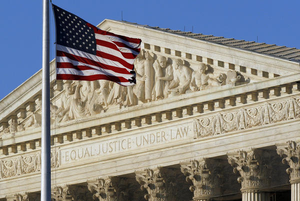 A U.S. flag flies in front of the Supreme Court in Washington.