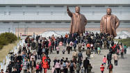 BEIJING -- North Korea celebrated the 101th anniversary of its founder's birth Monday with flowers and dancing instead of missiles, raising hopes that the regime may be climbing down from the furious rhetoric of recent weeks.