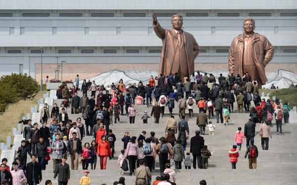 People visit giant statues of the late North Korean leaders, Kim Il Sung, left, and his son, Kim Jong Il, in the capital, Pyongyang.