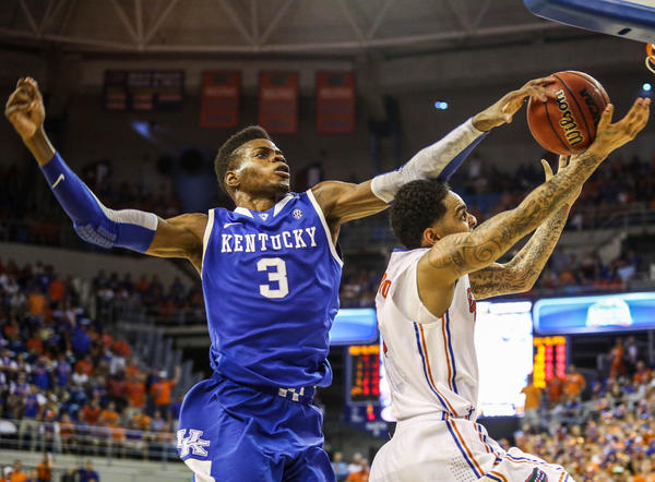 Florida guard Mike Rosario is fouled by Kentucky's Nerlens Noel during a February game.