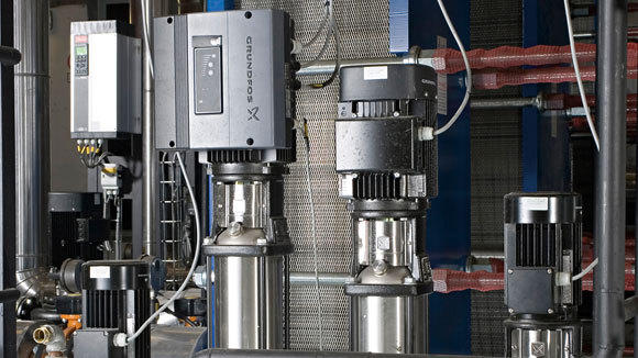 Grundfos pumps are shown at a heating plant.