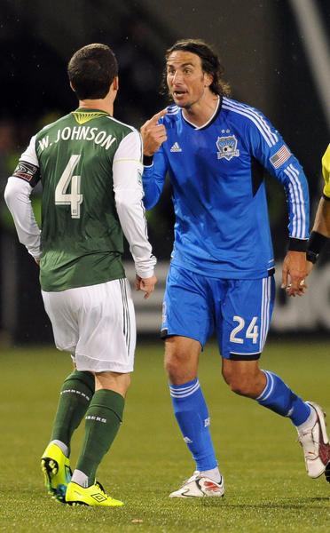 Portland Timbers midfielder Will Johnson (4) argues with San Jose Earthquakes forward Alan Gordon (24) during the second half of Sunday's game.