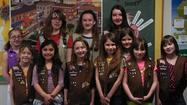 "On Sunday, April 7, 2013, four Cadette Girl Scouts from Troop 70649 helped seven Brownie Girl Scouts from Troop 70705 complete activities to earn the Junior Achievement ""Our Communities"" patch for Brownies. The Cadettes presented information on how a community works, the role of government, and money and banking. The Brownies learned the difference between unit production and assembly-line production by making paper donuts (and enjoyed some real donuts for their snack). They discussed making decisions, both big and small, and how those decisions can affect a community. The girls finished the afternoon by singing Girl Scout songs together."