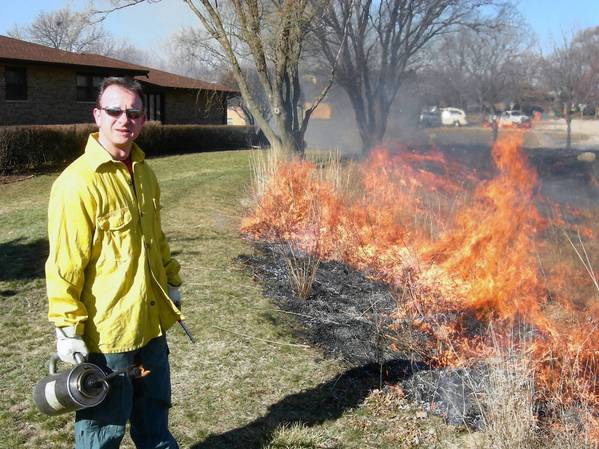 Bob Fleck burns brush and prairie plants at Muddy Waters Park in Westmont.