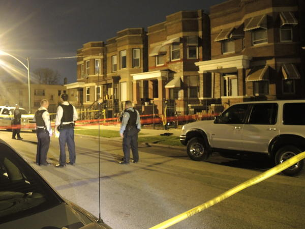 Police at the scene where a boy, 17, was shot in the neck about 10 p.m. Sunday.