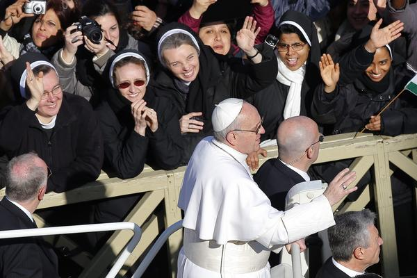 Nuns greet Pope Francis as he arrives in St. Peter's Square for his inauguration Mass at the Vatican last month. The pope has reaffirmed a crackdown by his predecessor, Benedict XVI, on American nuns.