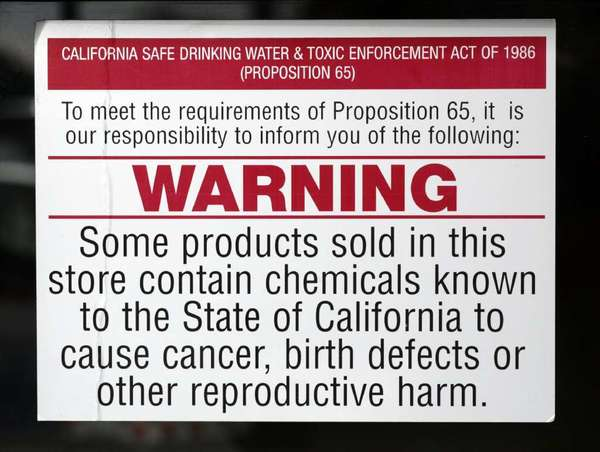 Warning signs such as this one in a Ventura County auto parts store were mandated under Proposition 65, passed by California voters in 1986.