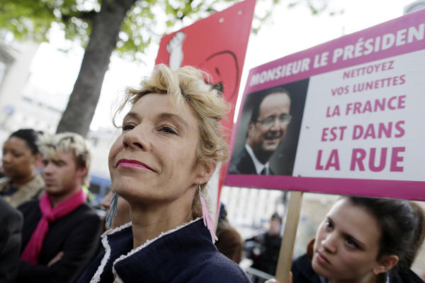 "Anti gay marriage activist Frigide Barjot talks to journalists during a press conference of the movement ""La Manif Pour Tous"" (Demonstration for all!), in front of the National Assembly in Paris."