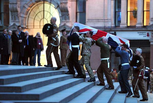Representatives of Britain's military services carry a coffin up the steps of St. Paul's Cathedral during a rehearsal for the funeral of former Prime Minister Margaret Thatcher.