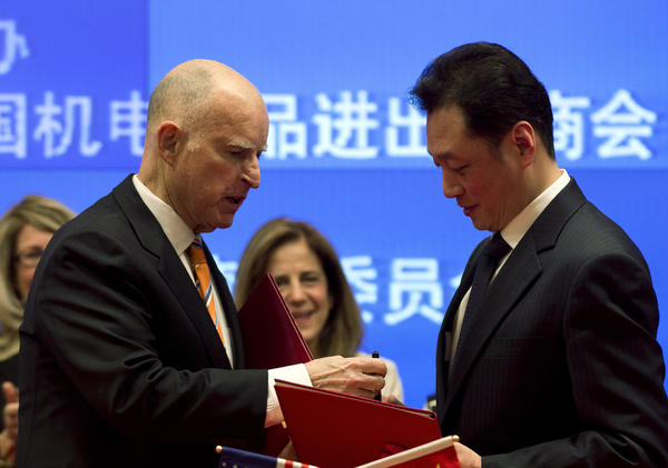 The environment has been a centerpiece of California Gov. Jerry Brown's week in China. Brown, left, exchanges a memorandum of understanding with Chinese Vice Minister of Commerce Wang Chao after a signing ceremony at a Beijing hotel.