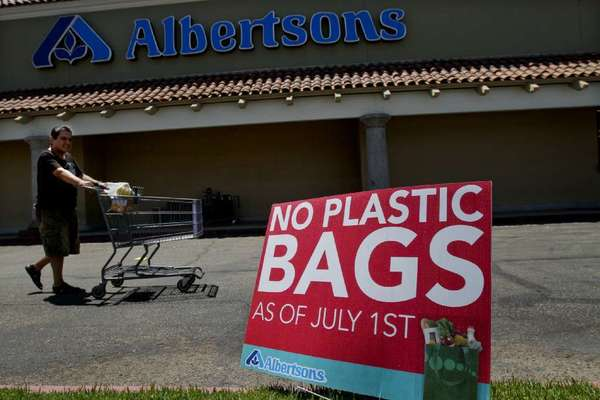 A sign outside a Hacienda Heights grocery store advises shoppers of the Los Angeles County ban on single-use plastic bags. The ban took effect July 1, 2011.