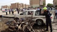 BEIRUT -- A string of bombings in Iraq claimed the lives of more than 30 people Monday in the run-up to provincial elections scheduled for this weekend.