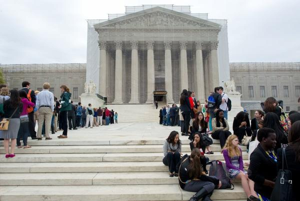 Crowds wait outside the Supreme Court as the justices prepared to hear arguments in the case against Myriad Genetics, which holds several patents on human genes.