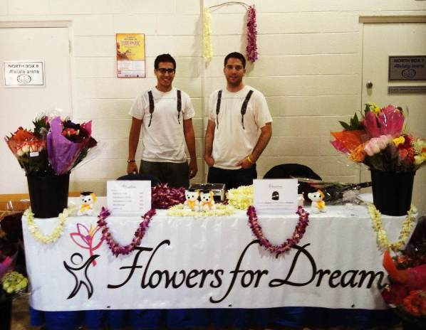Joseph Dickstein (left) and Steven Dyme (right) at one of four Flowers for Dreams stands selling congratulatory flower bouquets at DePauls University's commencement.