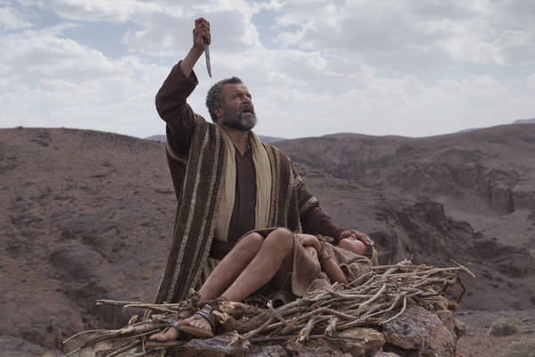 "Abraham (Gary Oliver) prepares Isaac (Hugo Rossi) for sacrifice in ""The Bible."""