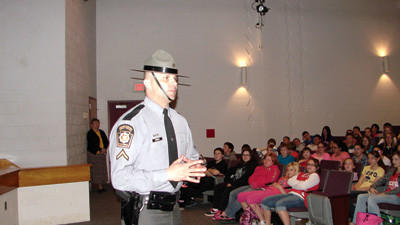 State police Trooper Jeffrey Brock, director of Camp Cadet of Somerset County, is shown speaking to students at Rockwood High School Monday afternoon.