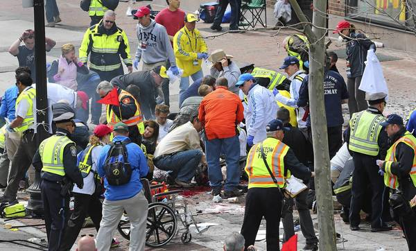 Emergency personnel respond to the scene after two explosions went off near the finish line of the 117th Boston Marathon