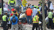 Emergency personnel respond to the scene after two explosions went off near the finish line of the Boston Marathon. (David L. Ryan/The Boston Globe)