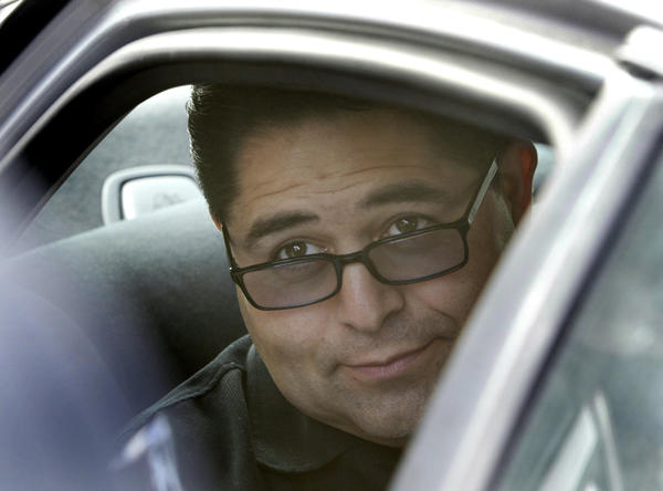 Former South Gate Treasurer Albert T. Robles is shown in an FBI vehicle after his arrest in 2004.
