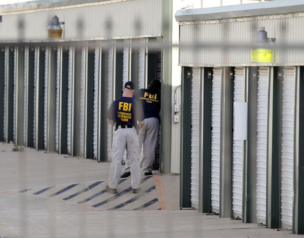 Authorities search a storage unit at Gibson Self Storage on Saturday as they continue to investigate the slayings of Kaufman County Dist. Atty. Mike McLelland, his wife and another top prosecutor in Texas.