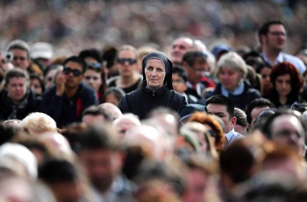"A nun watches Pope Francis hold Mass in Vatican City last month before his first Easter message. The Vatican said Francis had ""reaffirmed the findings of the assessment and the program of reform"" prescribed for the Leadership Conference of Women Religious."