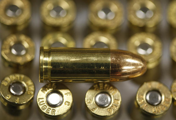 A 9-millimeter bullet rests on top of others in a box. A California lawmaker wants to put a five-cent tax on each bullet.
