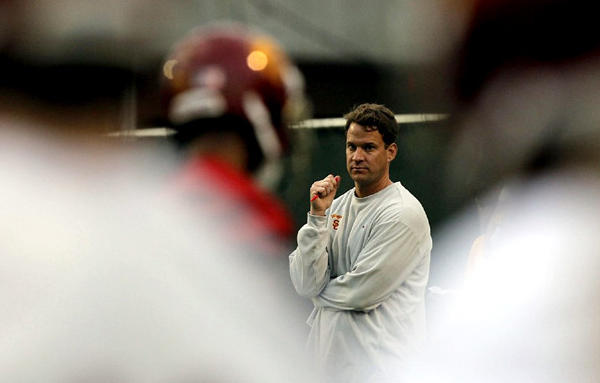 USC Coach Lane Kiffin watches the first day of spring practice.